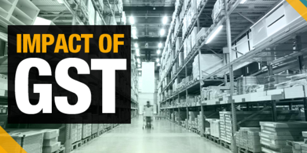 Huge distribution warehouse with high shelves and loaders with the text that showing the impact of GST on forefront.